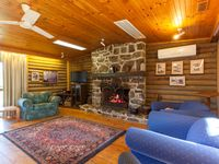The Sixth Hole living area features a large stone fireplace.