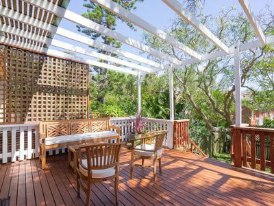 Large sunny deck with new outdoor setting