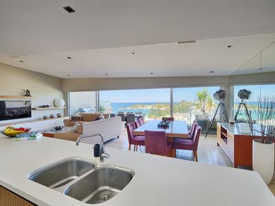Open plan living extends to balcony with views over Terrigal Beach and district