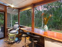 Your breakfast table overlooking the creek and rainforest