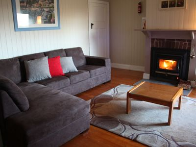 Loungeroom with roaring fire