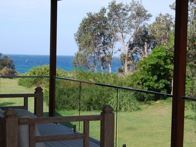 Relax on the daybed with views of Warrain Beach
