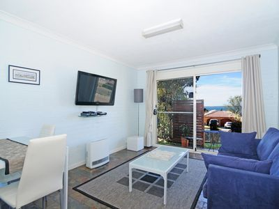 Comfortable lounge room, big screen TV with Foxtel, and fold out double sofa bed