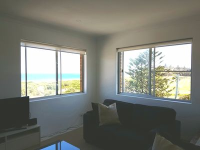 Lounge with view of ocean and golf course