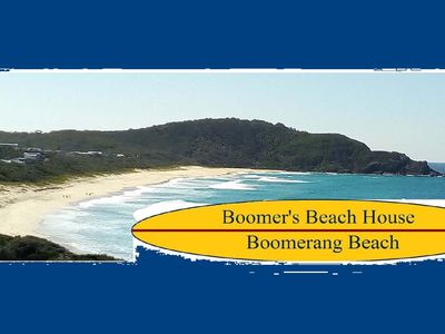 Sun lounges and day bed overlooking the sand and surf at Boomerang Beach