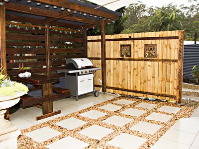 RIght outside your door is your own BBQ area with gas bbq and seating.