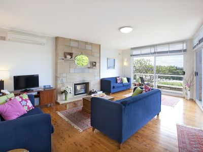 Sunny living room with gas log fire place