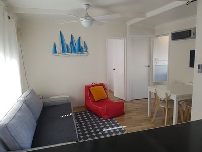 Loungeroom and dining with air con, heating, ceiling fans and TV/DVD