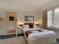Comfortable and well equipped master bedroom with queen size bed