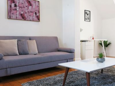 Spacious lounge room with Smart TV and a sofa bed which sleeps up to 2 people