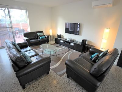 Spacious lounge with seating for 10+