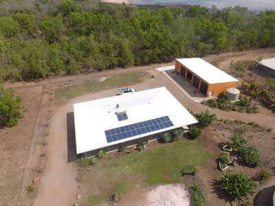 areal shot of property, Ocean in back ground, close