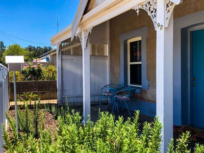 The front of Inglenook cottage, Moonta, with its veranda seating area