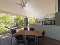 Outdoor patio features BBQ, pool table and dining table