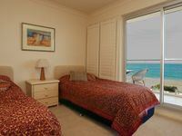 Second bedroom twin share with beach views