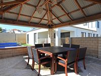 ALL WEATHER PERGOLA KEEPS THE SUN OFF YOU WHILE ENJOYING A FAMILY BBQ