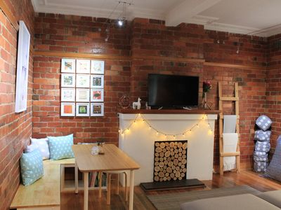 Open Plan living / dining with cosy dining nook and large comfortable couch