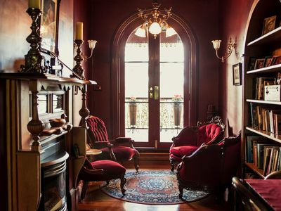 The Upstairs Red Velvet Reading Room leading out onto front Balcony.