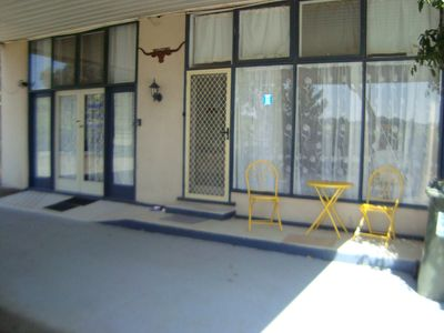 Apaartment frontage. Under large carport. Enter thru double glass doors