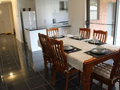 Lovely dining area. Open doors to outside undercover dining area