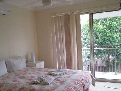 Main Bedroom with ensuite . Balcony patio setting