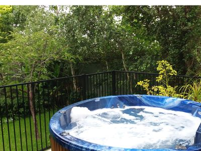 52 jet hot tub 7 person great for large or small groups private space to relax.
