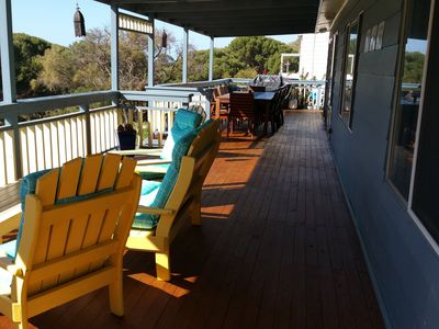 Expansive decking with dining table and BBQ