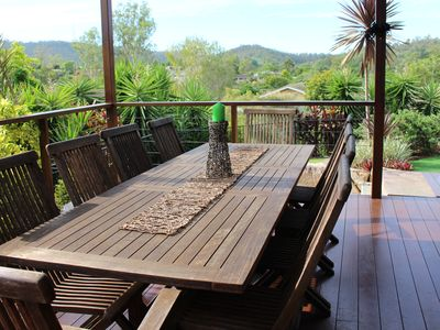 View of Mt Coot-tha from deck with 10 seater setting.