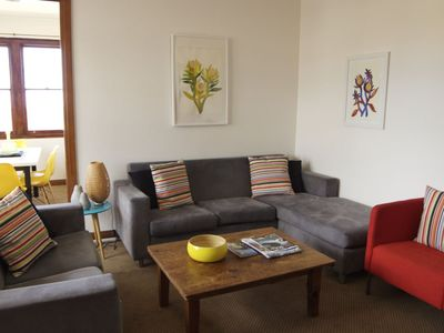 Get cosy in the bright lounge room, with plenty of space for everyone to relax.