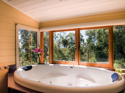 Avalon villa's luxurious 2 person spa bath with forest view