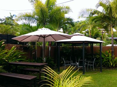 Bar & gazebo areas next to pool in private tropical gardens