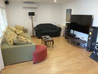 Surround sound and lots of lounging space in the media room