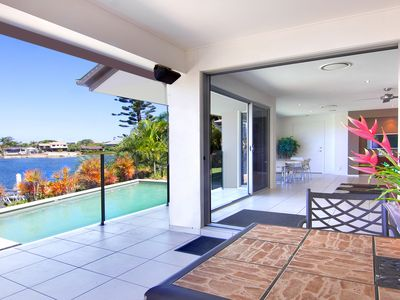 Open the full glass panoramic sliding doors and bring the outside in