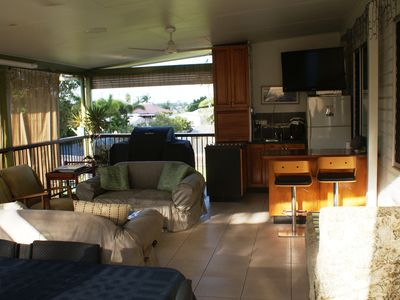 Deck entertaining area with kitchenette, BBQ and TV