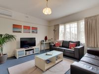 Spacious formal lounge with large LDC TV & DVD player