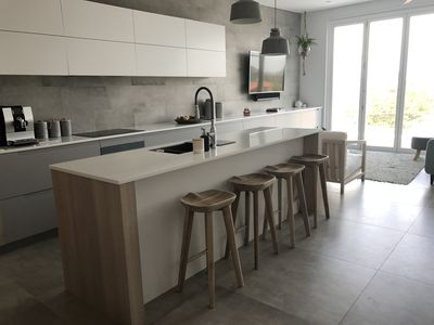 Open plan kitchen and living area, opening up onto huge balcony