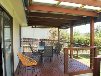 Relax on the deck overlooking golf course