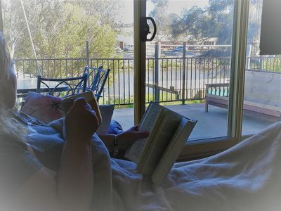 Relaxing with a good book by the fire, watching the Onkaparinga River flow by.