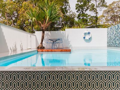 Freshly rebuilt, sophisticated, luxurious Queenslander beach house.