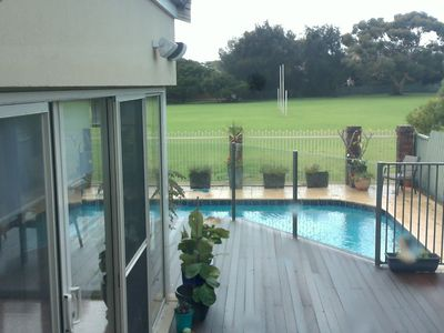 Pool Deck overlooking extensive Parklands at rear of property