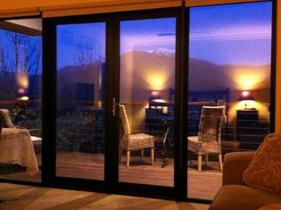 Looking to the Alps opposite from within one of the luxury spa chalets.