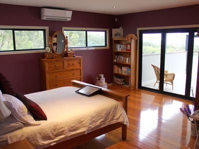 Spacious master bedroom with own large balcony overlooking the water