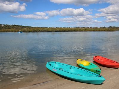 Double and single kayaks for you to use from our sandy beach