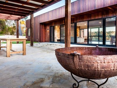 Covered terrace and fire pit