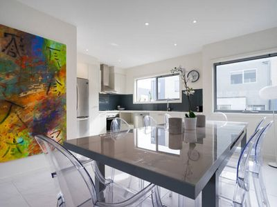 Spacious modern interior with designer appliances furnishings original artwork
