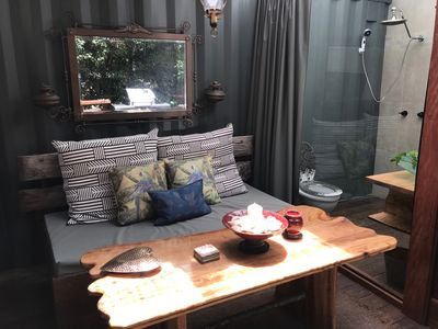 Oversized Day bed and table tucked in the Glass bush enclosure