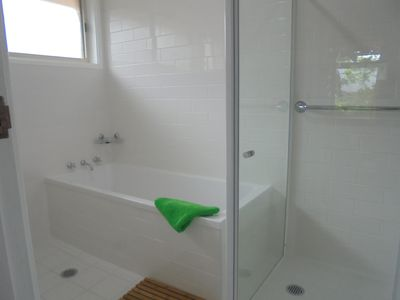Bathroom with Big Bathtub. Toilet is separate and adjacent to the bathroom.