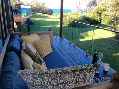 Balinese daybed on back deck with views of Warrain Beach