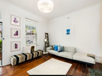 Living room, with large wall mounted tv.