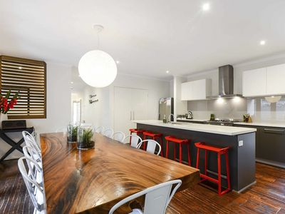 Large open plan kitchen with 12 seat dining table